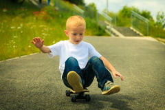 Skater boy child with his skateboard. Outdoor activity. Royalty Free Stock Images