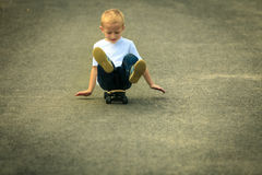 Skater boy child with his skateboard. Outdoor activity. Stock Photo