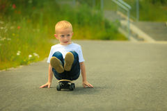 Skater boy child with his skateboard. Outdoor activity. Royalty Free Stock Image