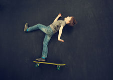Skater boy falling Royalty Free Stock Photos