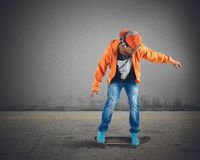 Skater. Boy runs and listens to music stock image