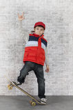 Skater boy showing V-sign Royalty Free Stock Photo