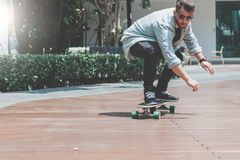 Skater boy skating longboard on the street stock photos