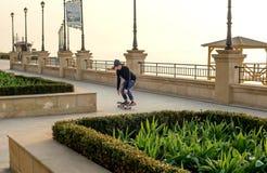 Skater boy skating on seaside Stock Photography