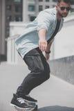 Skater boy on the street in Bangkok. royalty free stock photos
