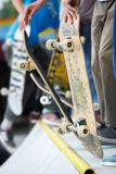 Group of skater boys compete in skate contest outdoor Stock Photography