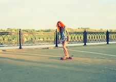 Skater caucasian women on skateboard at sunrise Stock Image