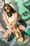 Skater Chic. Beautiful pretty young skater chic royalty free stock photography