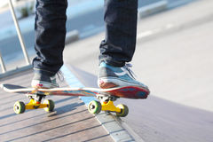 Skater. Close up view of a skater jumping on skateboard stock photography