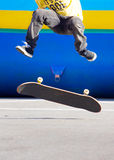 Skater. Close up view of a skater jumping on skateboard stock photos