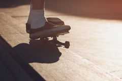 Skater does a grind trick. Royalty Free Stock Photography