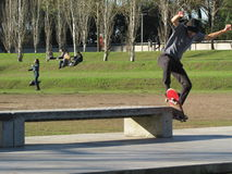 Skater. Doing acrobatics in a park bench Royalty Free Stock Photo