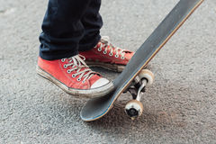 Skater doing flicking trick with skateboard tail Stock Image