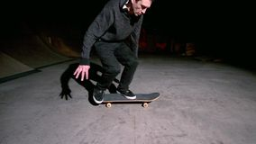 Skater doing 360 flip trick Stock Photos