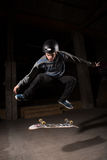 Skater doing kickflip trick Royalty Free Stock Image