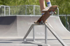 Skater doing nose grind on fun-box in skatepark Royalty Free Stock Image