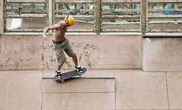 Skater doing tricks. Skateboarder in skate park stock images