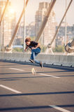 Skater doing tricks and jumping on the street highway bridge. Fr Royalty Free Stock Photos