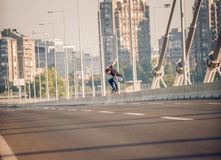 Skater doing tricks and jumping on the street highway bridge. Fr Royalty Free Stock Images