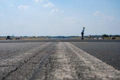 Skater on empty asphalt road / runway on former airport royalty free stock image