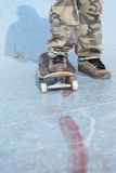 Skater foot over a skateboard Royalty Free Stock Images