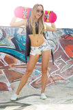Skater Girl. Beautiful and sexy street girl with her skateboard Royalty Free Stock Images