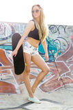 Skater Girl. Beautiful and sexy street girl with her skateboard Stock Image