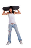 Skater girl holding skateboard behind her head Stock Images