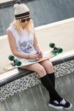 Skater Girl Listening  to Music Royalty Free Stock Photo