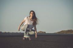 Skater girl making dowhill Stock Images