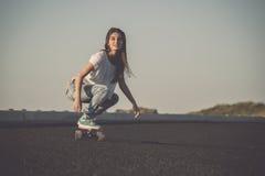 Skater girl making dowhill Stock Photos