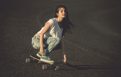 Skater girl making dowhill Stock Photo