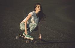Skater girl making dowhill Stock Photo