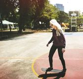Skater girl out in the city royalty free stock images
