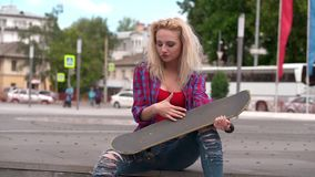 Skater girl outdoor playing with skateboard stock video footage