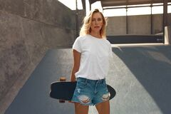 Free Skater Girl With Skateboard Portrait. Teenager In Casual Outfit Posing Against Concrete Ramp At Skatepark. Royalty Free Stock Photo - 195691225