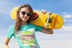 Skater girl. Young girl with skate board Stock Photography