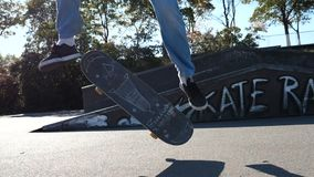 Skater goes the trick, Heelflip stock video footage