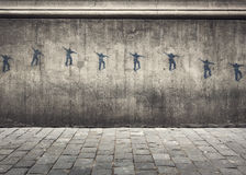 Skater Graffiti. Graffiti of a Skateboarder Jumping Through the Air on a Concrete Wall in the City Royalty Free Stock Photos