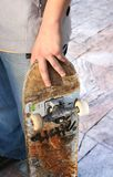 Skater guy. Photo of a skater, grunge board whit urban style Royalty Free Stock Photo