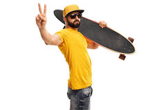 Skater guy making a peace sign Stock Images