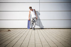 Skater holding his skateboard Stock Images