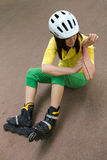 Skater injured and clutching arm Royalty Free Stock Images