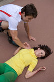 Skater injured and clutching arm Stock Image
