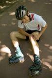 Skater injured and clutching leg Royalty Free Stock Image