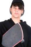 Skater joven con su patín Imagen de archivo libre de regalías