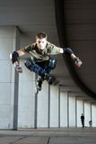 Skater jumping. In some building Royalty Free Stock Photography