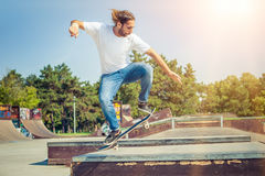 Skater jumping in skateboard park Royalty Free Stock Photography