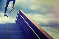 Skater. Jumps down the stairs royalty free stock photography