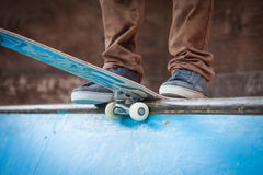 Skater jumps high in air. Under extrem-park Royalty Free Stock Image